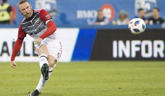 D.C. United's Wayne Rooney takes a free kick against the Montreal Impact during the first half of an MLS soccer match Saturday, Aug. 4, 2018, in Montreal. (Graham Hughes/The Canadian Press via AP) ** FILE **