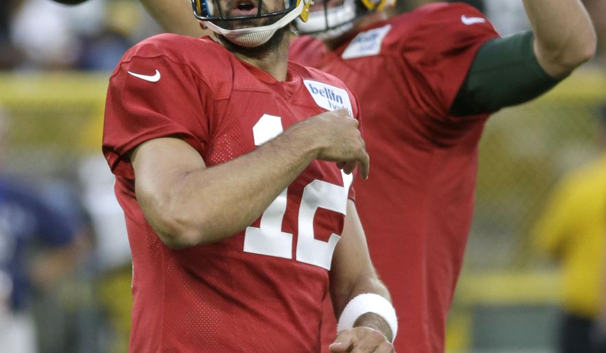 Green Bay Packers quarterback Aaron Rodgers reacts to one of his passes during a quarterbacks drill during the NFL football team's Family Night practice Saturday, Aug. 4, 2018, in Green Bay, Wis. (AP Photo/Mike Roemer)