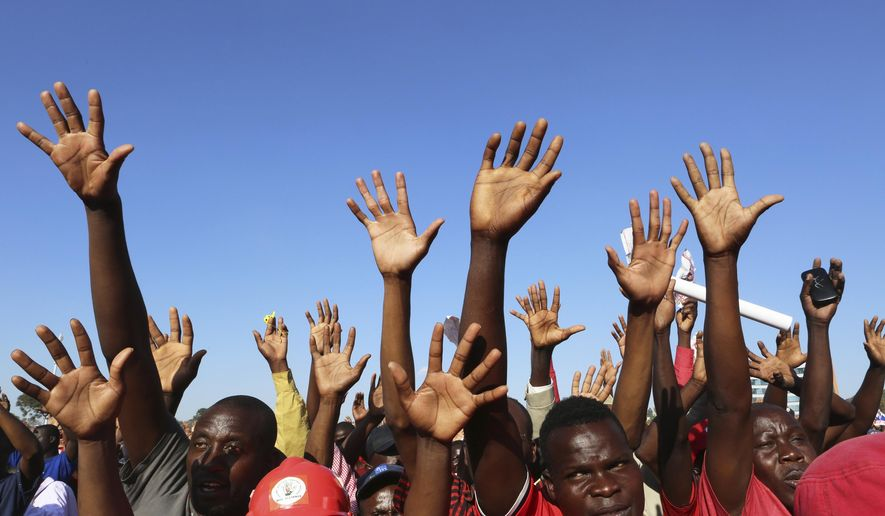Supporters of presidential candidate Nelson Chamisa raise their hands in support during his last rally in Harare, Zimbabwe, on Saturday, July, 28, 2018. On Thursday, the Zimbabwe Electoral Commission said President Emmerson Mnangagwa won the first election without Robert Mugabe on the ballot, ending a tumultuous week that began with optimistic scenes of peaceful voting, turned ugly with a deadly crackdown by soldiers in Harare, and ended with the prospect of a legal challenge over the result. (AP Photo/Tsvangirayi Mukwazhi)