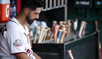 Washington Nationals starting pitcher Gio Gonzalez sits in the dugout after he was relieved during the fourth inning of the first baseball game of doubleheader against the Cincinnati Reds at Nationals Park, Saturday, Aug. 4, 2018, in Washington. (AP Photo/Alex Brandon)