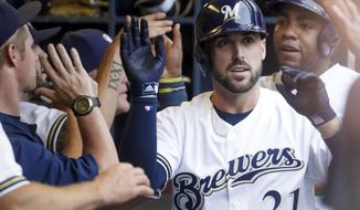 Milwaukee Brewers' Travis Shaw is congratulated after hitting a grand slam during the first inning of a baseball game against the Colorado Rockies Saturday, Aug. 4, 2018, in Milwaukee. (AP Photo/Morry Gash)