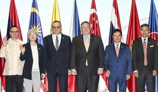From left; Philippines' Foreign Affairs Secretary Alan Cayetano, South Korea's Foreign Minister Kang Kyung-wha, Russia's Deputy Foreign Minister Igor Morgulov, U.S. Secretary of State Mike Pompeo, Vietnam's Foreign Minister Pham Binh Minh and Singapore's Foreign Minister Vivian Balakrishnan pose for a photo during the East Asia Summit Foreign Ministers Meeting on the sidelines of the 51st ASEAN Foreign Ministers Meeting in Singapore, Saturday, Aug. 4, 2018. (AP Photo/Yong Teck Lim)