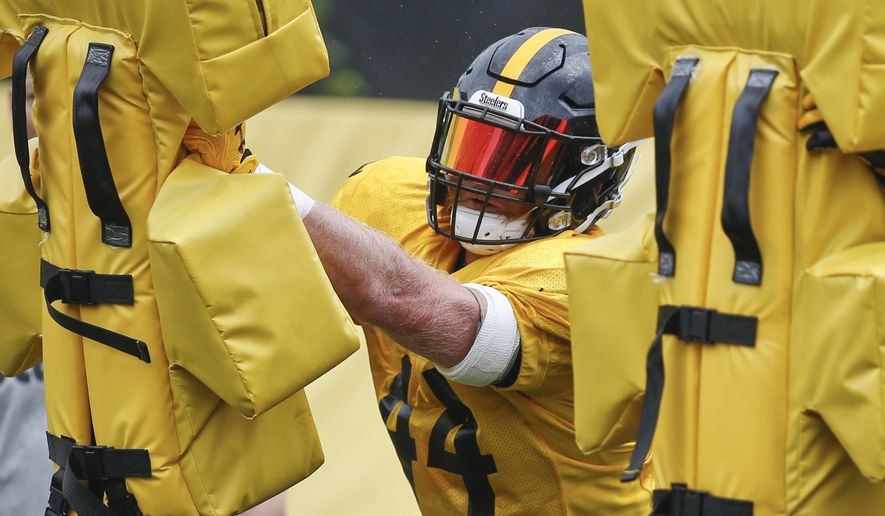 FILE-In this file photo from June 13, 2018, Pittsburgh Steelers linebacker Tyler Matakevich goes through drills during an NFL football practice in Pittsburgh. Matakevich and Jon Bostic find themselves in a battle for a starting inside linebacker spot in the Steelers defense. Both are attempting to fill the void left by the injured Ryan Shazier. (AP Photo/Keith Srakocic, File)