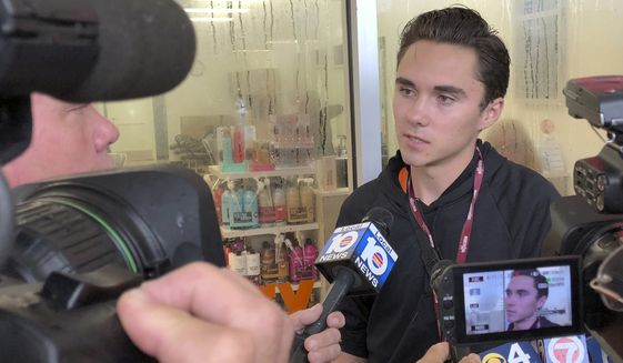 David Hogg, a student at Marjory Stoneman Douglas High School, speaks outside a Publix Supermarket in Coral Springs, Fla., Friday, May 25, 2018. (AP Photo/Terry Spencer) ** FILE **