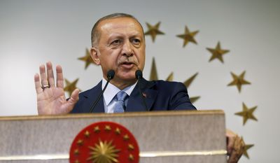 Turkey's President Recep Tayyip Erdogan delivers a statement on national television from his official residence in Istanbul, Sunday, June 24, 2018. Erdogan was proclaimed the winner early Monday of a landmark election that ushers in a government system granting the president sweeping new powers and which critics say will cement what they call a one-man rule. (AP Photo/Lefteris Pitarakis)