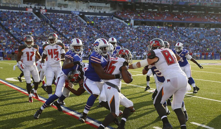 Tampa Bay Buccaneers kick returner Solomon Patton (86) is stopped by Kenny Ladler (31) during the second half of a preseason NFL football game against the Buffalo Bills Saturday, Aug. 23, 2014, in Orchard Park, N.Y. (AP Photo/Bill Wippert)