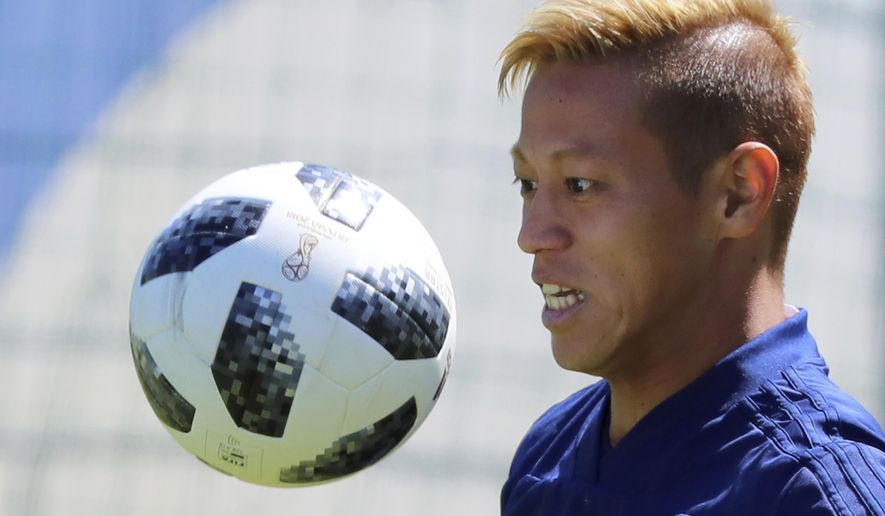 FILE - In this June 17, 2018, file photo, Japan's Keisuke Honda warms up during a training session of the Japan national soccer team at the 2018 soccer World Cup in Kazan, Russia. Melbourne Victory confirmed on Monday, Aug. 6, 2018, the signing of Honda for the 2018-2019 Australian A-League season. (AP Photo/Eugene Hoshiko, File)
