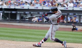 Atlanta Braves' Nick Markakis hits a home run during the tenth inning of a baseball game against the New York Mets Sunday, Aug. 5, 2018, in New York. (AP Photo/Frank Franklin II)
