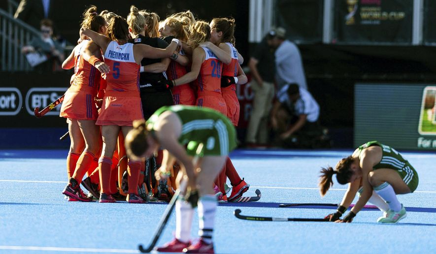 The Netherlands team celebrate at the end of the Women's Hockey World Cup Final match between the Netherlands and Ireland, at The Lee Valley Hockey and Tennis Centre, in London, Sunday Aug. 5, 2018. (Paul Harding/PA via AP)