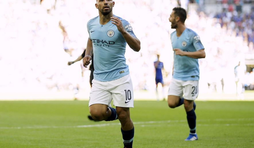Manchester City's Sergio Aguero celebrates scoring his second goal of the game during the Community Shield soccer match between Chelsea and Manchester City at Wembley, London, Sunday, Aug. 5, 2018. (AP Photo/Tim Ireland)