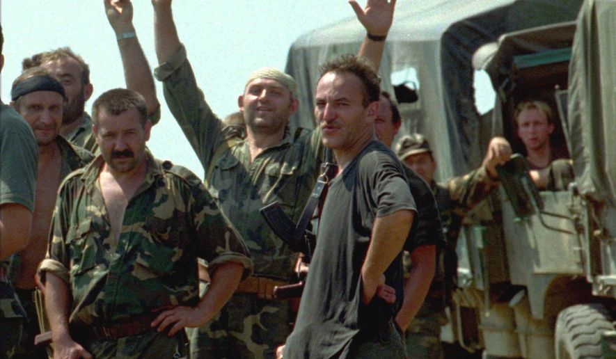 FILE - In this Saturday, Aug. 5, 1995 file photo, Croatian soldiers celebrate their victory after retaking the town of Dubica, on the northern Bosnian border. Croatia on Sunday, Aug. 5, 2018 celebrated a victorious 1995 military offensive in which it retook lands held by rebel Serbs, while Serbia's president compared the operation to the policies of Nazi Germany. (AP Photo/Robert Belosevic, File)