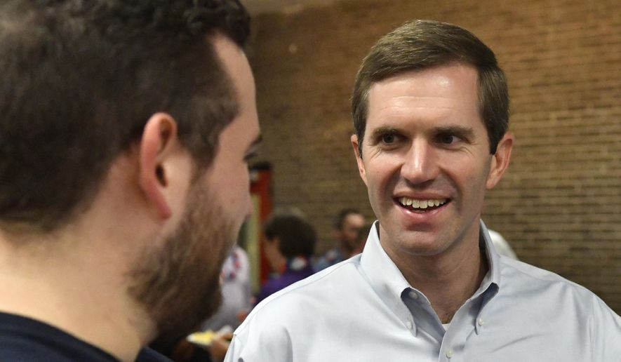 Kentucky Attorney General and democratic candidate for Governor Andy Beshear speaks to a supporter at the Graves County Democratic Breakfast, Saturday, Aug. 4, 2018, in Mayfield, Ky. (AP Photo/Timothy D. Easley)