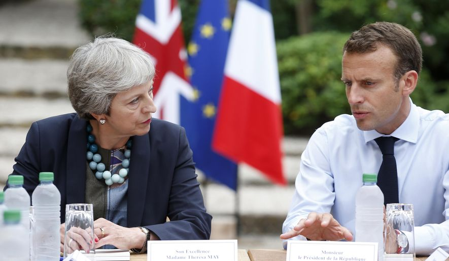 French President Emmanuel Macron, right, meets with British Prime Minister Theresa May to discuss Brexit issues at the Fort de Bregancon in Bornes-les-Mimosas, southern France, Friday Aug. 3, 2018. (Sebastien Nogier, pool via AP)
