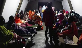 People affected by the earthquake rest at a temporary shelter in Lombok, Indonesia, Sunday, Aug. 5, 2018. A strong earthquake struck Indonesia's popular tourist island of Lombok on Sunday, triggering a tsunami warning, one week after another quake in the same area killed more than a dozen people. (AP Photo)