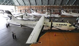 In this photo provided by Tasnim News Agency, Iran Air's new commercial aircrafts are parked at Mehrabad airport in Tehran, Iran, Sunday, Aug. 5, 2018. Iran has acquired five new ATR72-600 airplanes from ATR, jointly owned by European consortium Airbus and Italy's Leonardo, a day before the U.S. begins restoring sanctions suspended under the 2015 nuclear deal. (Mohammad Hassanzadeh/Tasnim News Agency via AP)