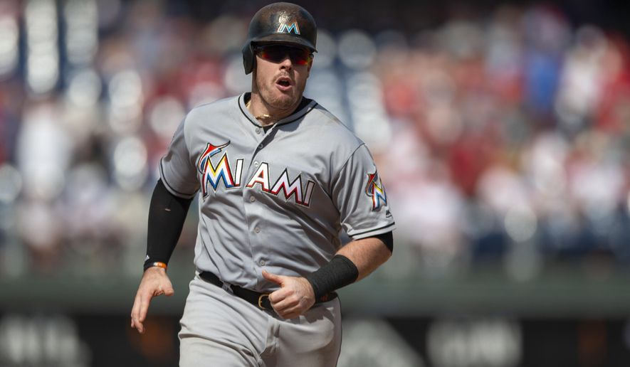 Miami Marlins' Justin Bour runs the bases after hitting a home run in the seventh inning of a baseball game against the Philadelphia Phillies, Sunday, Aug. 5, 2018, in Philadelphia. The Phillies won 5-3. (AP Photo/Laurence Kesterson)