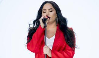 "FILE - In this Saturday, March 24, 2018, file photo, Demi Lovato performs ""Skyscraper"" during the ""March for Our Lives"" rally in support of gun control in Washington. Lovato says in her first public comments since an overdose put her into the hospital that she remains committed to overcoming addiction. In a post on Instagram, Lovato thanked her fans, family, team and staff at Cedars-Sinai hospital in Los Angeles. She reportedly overdosed on drugs on July 24. (AP Photo/Andrew Harnik, File)"