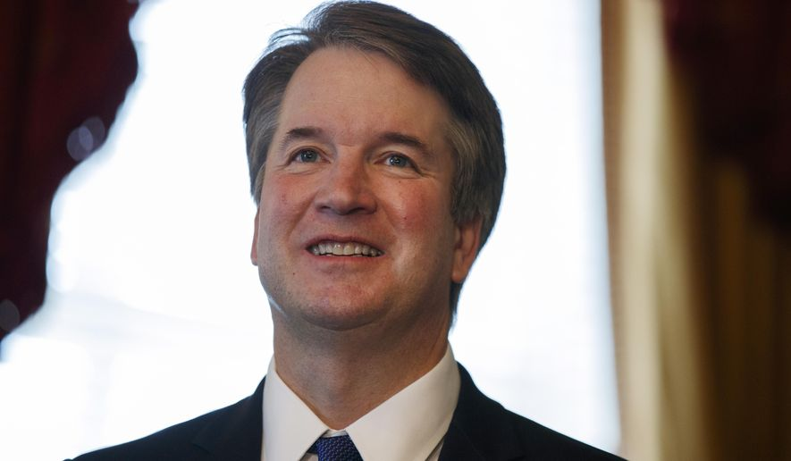 In this July 11, 2018, file photo, Supreme Court nominee Brett Kavanaugh smiles during a meeting with Sen. Orrin Hatch, R-Utah, on Capitol Hill in Washington. (AP Photo/Evan Vucci, File)