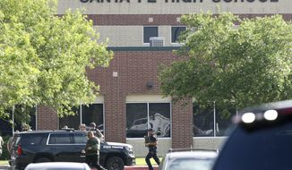FILE - In this May 18, 2018, file photo, law enforcement officers respond to Santa Fe High School after an active shooter was reported on campus in Santa Fe, Texas. Republican leaders in gun-friendly Texas are stamping down the prospects of 'red flag' laws that would let enforcement seize some firearms from people who are deemed dangerous to themselves or others. Gun control advocates hoped for an opening after mass shootings at a Texas church and high school within 6 months of each other. (Steve Gonzales/Houston Chronicle via AP, File)