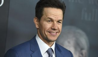 """FILE - In this Dec. 18, 2017 file photo, Mark Wahlberg arrives at the world premiere of """"All the Money in the World"""" at the Samuel Goldwyn Theater in Beverly Hills, Calif.  Wahlberg is looking for a few tough guys to appear in his latest movie.Boston Casting says auditions will be held Saturday, Aug. 4, 2018  at its offices in the city's Allston neighborhood, and it's encouraging """"real people"""" with """"tough faces"""" to answer the call. (Photo by Jordan Strauss/Invision/AP, File)"""