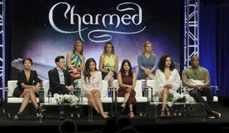 "Executive producers Jessica O'Toole, from back row left, Jennie Snyder Urman, Amy Rardin, and from front row left, Ellen Tamaki, Rupert Evans, Sarah Jeffery, Melonie Diaz, Madeleine Mantock and Ser'Darius Blain participate in the ""Charmed"" panel during the CW Television Critics Association Summer Press Tour at The Beverly Hilton hotel on Monday, Aug. 6, 2018, in Beverly Hills, Calif. (Photo by Willy Sanjuan/Invision/AP)"