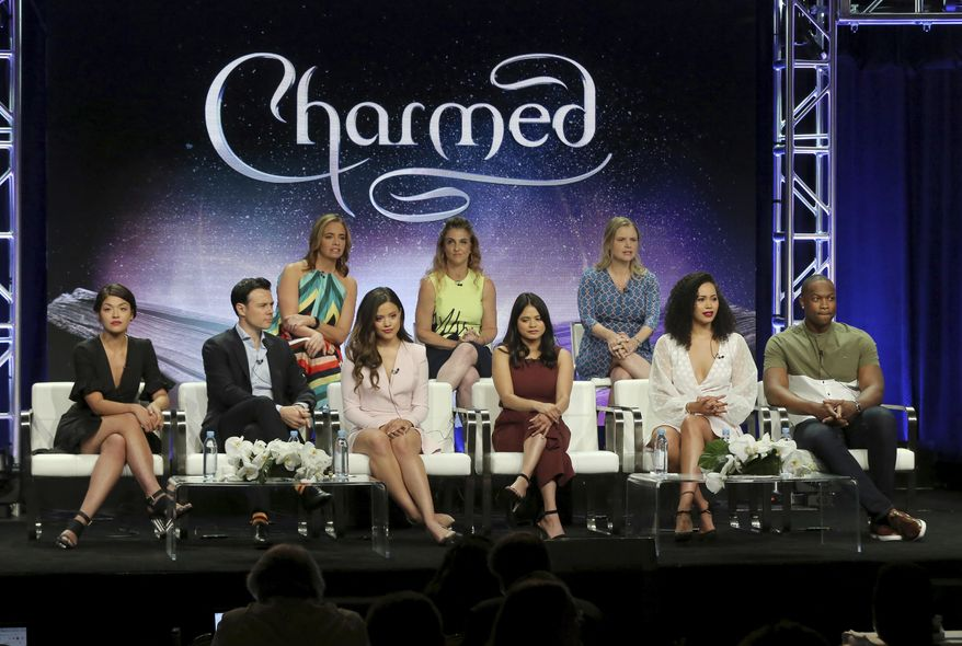 """Executive producers Jessica O'Toole, from back row left, Jennie Snyder Urman, Amy Rardin, and from front row left, Ellen Tamaki, Rupert Evans, Sarah Jeffery, Melonie Diaz, Madeleine Mantock and Ser'Darius Blain participate in the """"Charmed"""" panel during the CW Television Critics Association Summer Press Tour at The Beverly Hilton hotel on Monday, Aug. 6, 2018, in Beverly Hills, Calif. (Photo by Willy Sanjuan/Invision/AP)"""