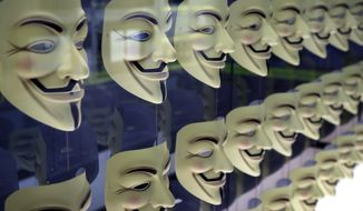 In this Monday, Feb. 12, 2018 photo, Guy Fawkes masks, often associated with the hacker group Anonymous, are displayed in a section about hacking at SPYSCAPE in New York. Visitors to a new attraction opening in New York City can learn about the elements of spying, its history and find out what kind of spy they could be. SPYSCAPE opens Friday. (AP Photo/Seth Wenig)
