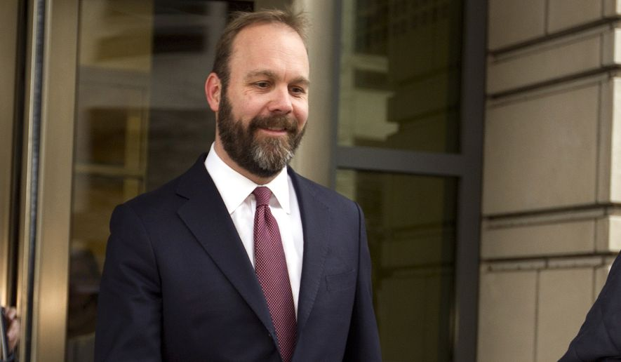 In this Feb. 23, 2018, file photo, Rick Gates leaves federal court in Washington. (AP Photo/Jose Luis Magana, File)