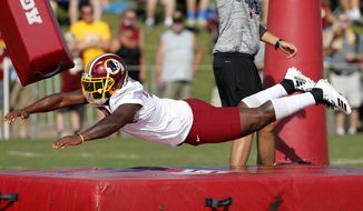 Washington Redskins NFL football player Byron Marshall runs a drill during training camp in Richmond Va., Mon. Aug. 6, 2018. (Mark Gormus/Richmond Times-Dispatch via AP)/Richmond Times-Dispatch via AP)