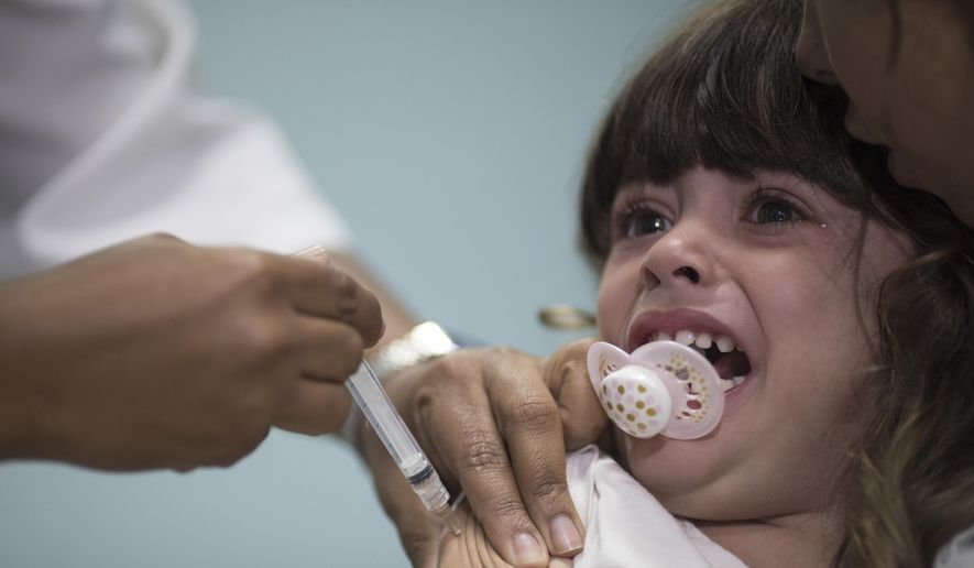Lara Melo, 3-year-old, receives a vaccine against measles in Rio de Janeiro, Brazil, Monday, Aug. 6, 2018. Brazilian health authorities launched a nationwide vaccination campaign against measles and polio, two diseases that are showing up in larger numbers in Latin America's largest nation after being all but eradicated. (AP Photo/Leo Correa)