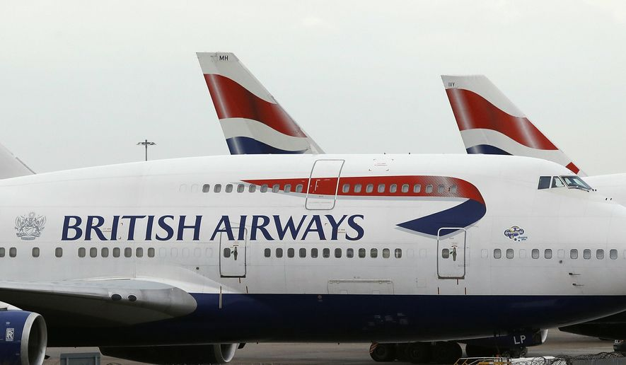 In this Tuesday, Jan. 10, 2017, file photo, British Airways planes are parked at Heathrow Airport during a 48hr cabin crew strike in London. (AP Photo/Frank Augstein, file)
