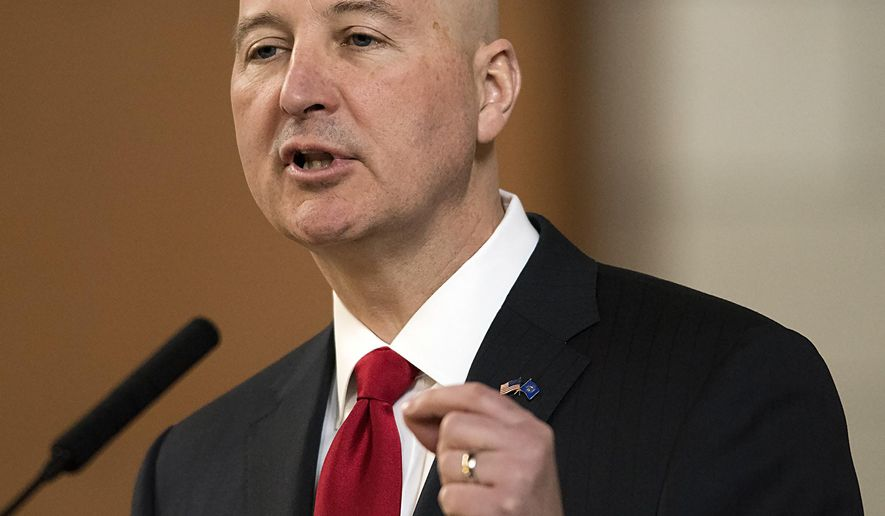 "FILE - In this April 18, 2018, file photo, Nebraska Gov. Pete Ricketts speaks at the legislature, in Lincoln, Neb. Pope Francis' decree that the death penalty is ""inadmissible"" in all cases could pose a dilemma for Roman Catholic politicians and judges in the United States. Ricketts, a Republican and Catholic who worked to reinstate capital punishment in his state after lawmakers abolished it in 2015, said the pope's decree doesn't change his stance. (Gwyneth Roberts/Lincoln Journal Star via AP, File)"
