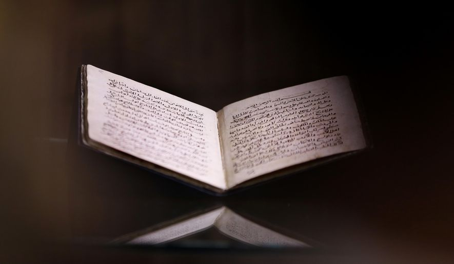 """A 500-year-old manuscript, titled """"The Summary of the Science of History,"""" is displayed during a press conference in Cairo, Egypt, Monday, Aug. 6, 2018. Egypt's national library said Monday that it retrieved the manuscript that was lost in the 1970s on July 13 after it was spotted at an auction in London in April. (AP Photo/Amr Nabil)"""