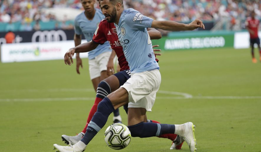 Manchester City's Riyad Mahrez, right, goes for the ball during the first half of an International Champions Cup tournament soccer match against FC Bayern, Saturday, July 28, 2018, in Miami Gardens, Fla. (AP Photo/Lynne Sladky)