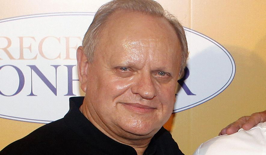 "In this Sept. 7, 2014, file photo, French chef Joel Robuchon poses for photographers during a photocall for the movie ""The Hundred-Foot Journey"", in Paris, Sunday, Sept. 7, 2014. French master chef Joel Robuchon has died at the age of 73. (AP Photo/Thibault Camus, File)"