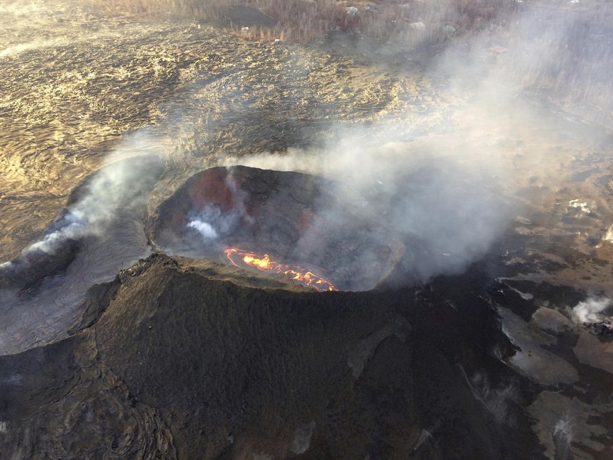 In this Sunday, Aug. 5, 2018 aerial photo provided by the U.S. Geological Survey, lava from the last active eruption site on Hawaii's Kilauea volcano is shown near Pahoa, Hawaii. The volcano changed dramatically over the weekend as lava from the site slowed and fewer earthquakes were recorded across the region. The pause in volcanic activity comes as Hurricane Hector moves closer to Hawaii, a storm that is expected to pass south of the Big Island Tuesday night and Wednesday as it moves westward. (U.S. Geological Survey via AP)