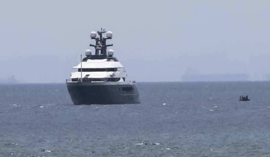 """Luxury yacht """"Equanimity"""" is anchored in the waters off Batam Island, Indonesia, Monday, Aug. 6, 2018. Malaysia's prime minister Mahathir Mohamad said Indonesia has handed over the luxury yacht allegedly bought with money stolen in the multibillion-dollar looting of a state investment fund. (AP Photo/Djalu)"""