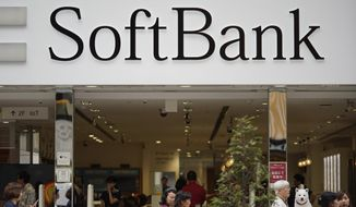 This June 14, 2018, photo, shows the logo of Japanese mobile provider SoftBank at its shop in Tokyo. Japanese technology company Softbank said Monday, Aug 6, 2018, its profits grew to 313.7 billion yen ($2.8 billion) in the latest quarter as it realized gains from sales by its Softbank Vision investment fund. (AP Photo/Shuji Kajiyama)