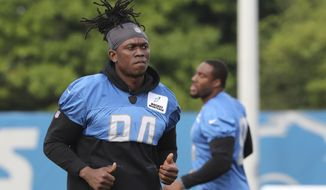 FILE - In this Aug. 1, 2018, file photo, Detroit Lions defensive end Ezekiel Ansah jogs during NFL football practice in Allen Park, Mich. The Detroit Lions have removed defensive end Ziggy Ansah from the active/physically unable to perform list. The Lions announced the move Monday, Aug. 6, 2018. (AP Photo/Carlos Osorio, File)