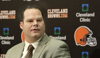 FILE - In this Jan. 14, 2011, file photo, Cleveland Browns general manager Tom Heckert speaks at a news conference in Berea, Ohio. The Broncos say former personnel executive Tom Heckert died Sunday night, Aug. 5, 2018, following a long illness. Heckert, 51, stepped away from the Broncos after last season after being diagnosed in recent years with amyloidosis, a rare disease that causes a buildup of amyloid proteins in the heart, kidney, liver and other organs. (AP Photo/Amy Sancetta, File)