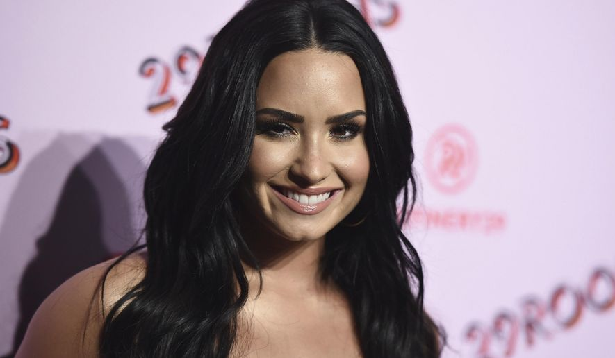 FILE - In this Dec. 6, 2017 file photo, Demi Lovato arrives at the West Coast debut of 29rooms at ROW DTLA in Los Angeles. Lovato has checked out of the hospital she was rushed to two weeks ago for a reported overdose. A person close to Lovato says she was released from Cedars-Sinai hospital in Los Angeles over the weekend.  Lovato was hospitalized on July 24. (Photo by Jordan Strauss/Invision/AP, File)