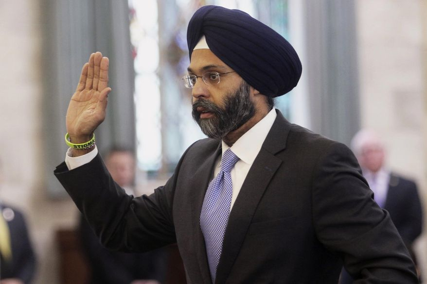 "FILE - In this Jan. 16, 2018, file photo, Gurbir Grewal is sworn in before testifying in front of the senate judiciary committee in Trenton, N.J. WKXW-FM hosts Dennis Malloy and Judi Franco, the hosts of a popular New Jersey radio show suspended for calling Grewal, the nation's first Sikh attorney general ""turban man,"" are back on the air Monday, Aug. 6, after a 10-day suspension. (Chris Pedota /The Record via AP, File)"