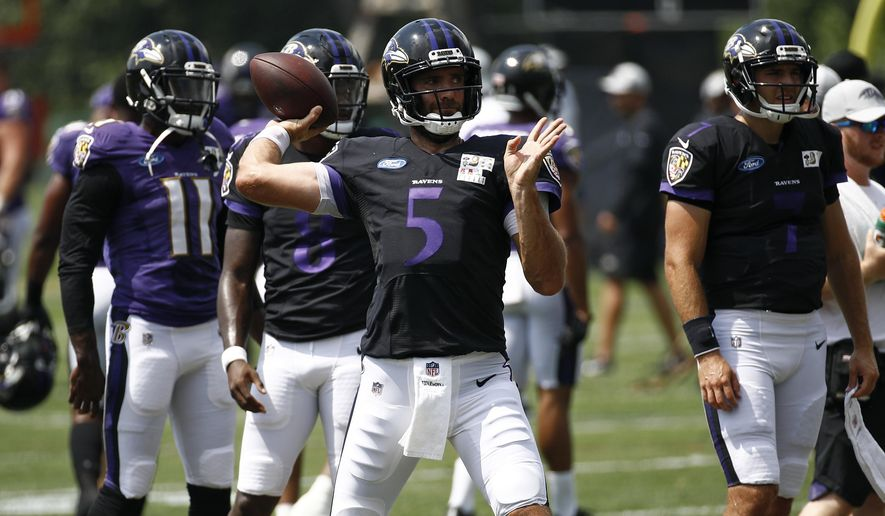Baltimore Ravens quarterback Joe Flacco (5) throws a pass during a joint NFL football training camp practice with the Los Angeles Rams at the Raven's headquarters, Monday, Aug. 6, 2018, in Owings Mills, Md. (AP Photo/Patrick Semansky)