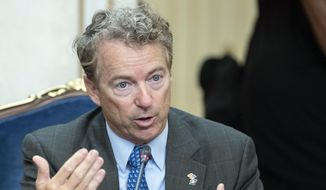 Sen. Rand Paul speaks during his meeting with Russian lawmakers in Moscow, Russia, Monday, Aug. 6, 2018. Paul said he invited Russian lawmakers to visit the United States to help foster inter-parliamentary contacts. (AP Photo/Pavel Golovkin)