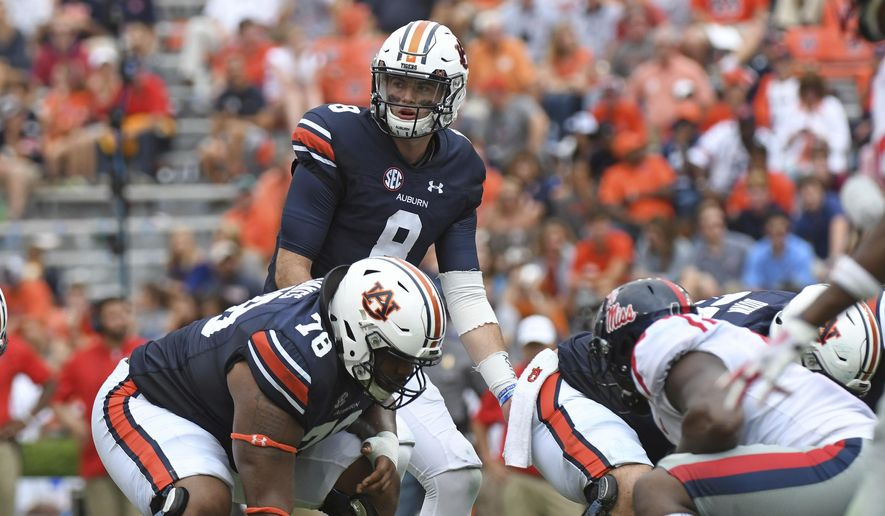 FILE - In this Oct. 7, 2017, file photo, Auburn quarterback Jarrett Stidham (8) looks to the sideline during the second half of an NCAA college football game against Mississippi, in Auburn, Ala. Last season scoring was down in college football, a drop of about a point and a half per game per team to 28.8, and the lowest mark since 2011 (28.3). But a deeper look into the numbers shows that defensive coordinators don't have much to celebrate. Offenses are still performing at a high level. They were, generally, just operating more slowly in 2017. And there is reason to believe this is the new normal as the allure of playing fast. (AP Photo/Thomas Graning, File)