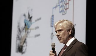Johann Ebenbichler, BMW's vice president on quality management, speaks during a press conference in Seoul, South Korea, Monday, Aug. 6, 2018. BMW AG's Korean unit apologized over engine fires that prompted recalls and a probe Monday, in its latest efforts to contain the damage as images of the German cars engulfed in flames stoked safety worries. (AP Photo/Ahn Young-joon)