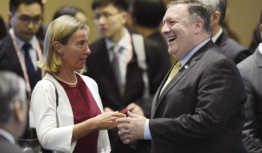 U.S. Secretary of State Mike Pompeo , right, speaks to European Union's Foreign Policy Chief Federica Mogherini ahead of the at the 25th ASEAN Regional Forum Retreat in Singapore, Saturday, Aug. 4, 2018. (AP Photo/Joseph Nair)