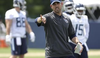 FILE - In this May 22, 2018, file photo, Tennessee Titans offensive coordinator Matt LaFleur runs a drill during an organized team activity at the Titans' NFL football training facility in Nashville, Tenn. LaFleur makes his debut calling plays for the Titans' offense on Thursday night, Aug. 9 in Green Bay. (AP Photo/Mark Humphrey, File)