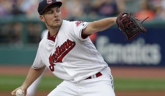 Cleveland Indians starting pitcher Trevor Bauer delivers in the first inning of a baseball game against the Minnesota Twins, Monday, Aug. 6, 2018, in Cleveland. (AP Photo/Tony Dejak)