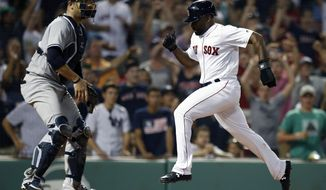 Boston Red Sox's Jackie Bradley Jr., right, scores in front of New York Yankees' Austin Romine after a throwing error by Miguel Andujar during the ninth inning of a baseball game in Boston, Monday, Aug. 6, 2018. (AP Photo/Michael Dwyer)